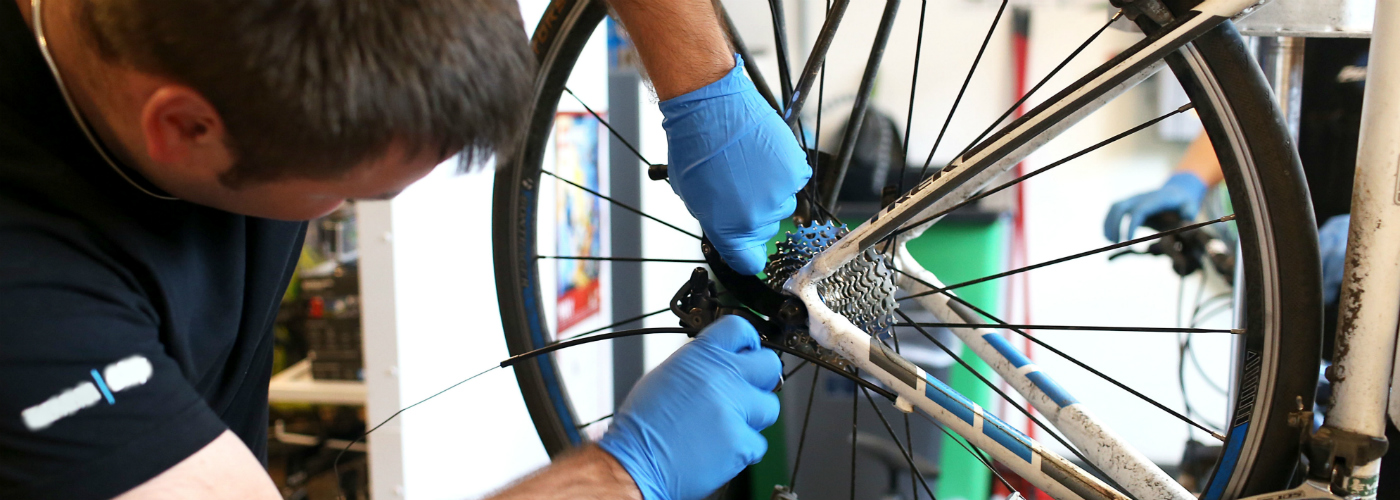Offender working on a bike in the cycle workshop.